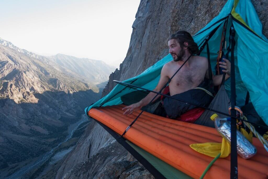 Waking up stoked, in a tent dangling from the side of a big rock climbing wall in Kyrgyzstan. Photo ©SamuelWilson2018.