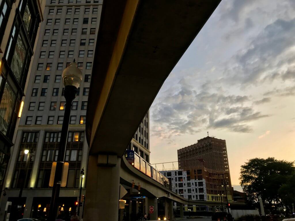 Underneath Detroit's People Mover – part of the public transit train system – at sunset.