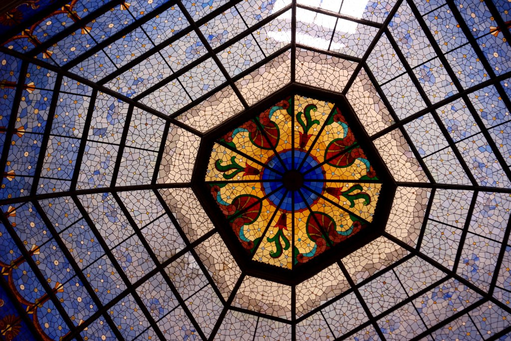 Colorful stained glass ceiling inside the Indiana state capitol building in Indianapolis. ©KettiWilhelm2019