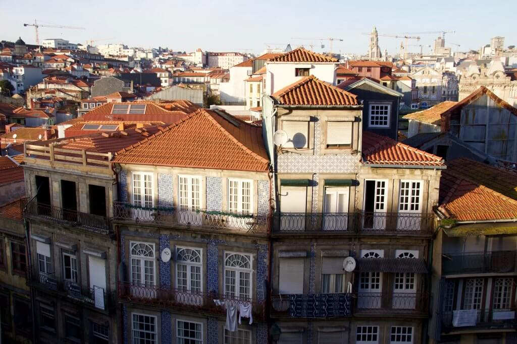 Cranes filling up the skyline of Porto, Portugal, where many buildings are being renovated. ©KettiWilhelm2020